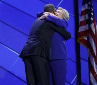 Watch Former Rivals Obama, Clinton Embrace Onstage