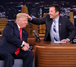 Trump tells Jimmy Fallon: 'be a man.' Late-night host answers with donation to help migrants.
