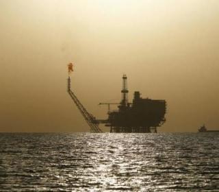Oil Tops $55 a Barrel After OPEC Deal Success