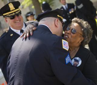 Mother of Slain Police Officer Serves Hundreds Holiday Dinner