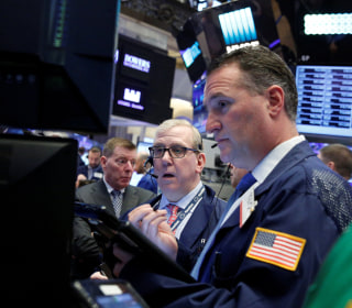 Stocks Trim Losses As Investors Weigh Trump's Tax Reform