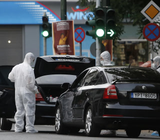 Former Greek Prime Minister Lucas Papademos Injured by Explosion in Car