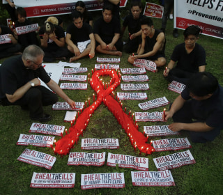 Travel policies make U.S. unsafe for AIDS conference, activists say
