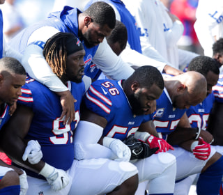 NFL Players Link Arms, Kneel After Trump Criticizes Protests