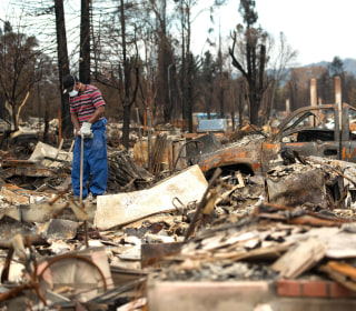 California Fires Destroyed 8,400 Buildings, Evacuees Check Homes