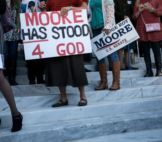 Anti-gay supporters rally for Roy Moore, worrying LGBTQ community