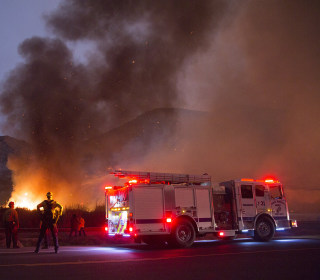 Southern California wildfire devours homes as residents escape