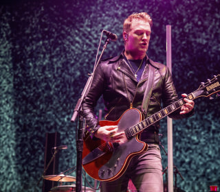Josh Homme of Queens of the Stone Age apologizes for kicking photographer in face