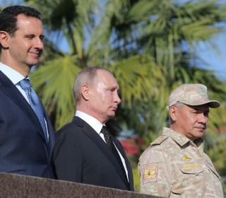Putin praises Russian military in Syria visit, announces partial withdrawal