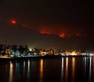 California coast battles massive wildfire