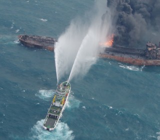 Oil clumps wash ashore in Japan after tanker carrying 1 million barrels sinks