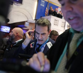Dow takes a wild ride after dramatic losses; ends day on a session high
