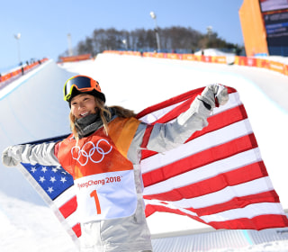 Gold medalist Chloe Kim shares Sports Illustrated cover — with her dog