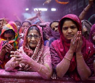 Colored powder flies as Hindus celebrate Holi