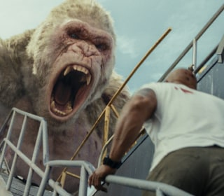 In a close race, 'Rampage' takes No. 1 from 'A Quiet Place'