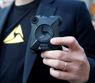 Axon's police body cams could be getting an AI upgrade. Civil rights groups are worried.