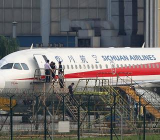 Sichuan Airlines co-pilot sucked halfway out cockpit window, pilot says