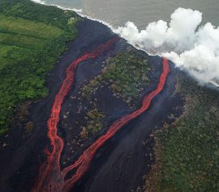 Dramatic images capture lava exploding as it reaches Pacific
