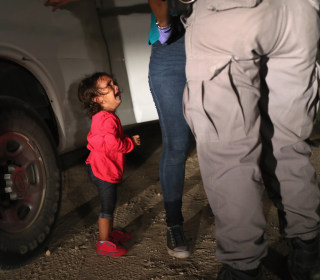 Time issues correction for photo of crying 2-year-old migrant