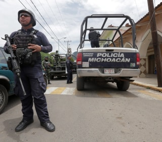 Mexico detains town's entire police force days after mayoral candidate's killing