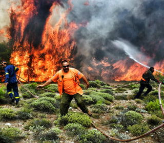 Wildfires raging in Greece kill dozens