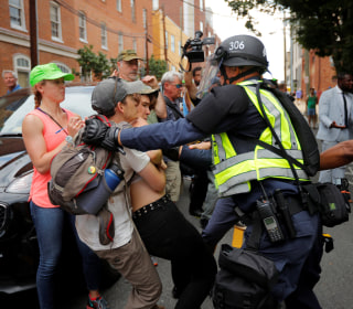 Police and protesters come out in force on first anniversary of Charlottesville