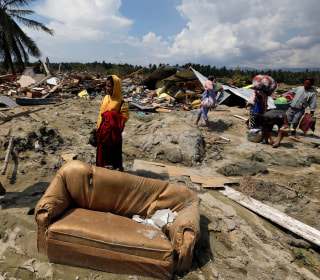 In Indonesia, parents wait for children's bodies to be pulled from church wreckage