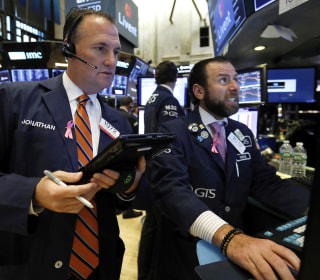 The Dow plummets for a second straight day as Nasdaq flirts with correction