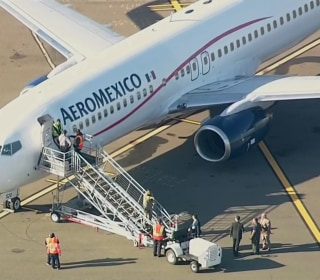 2 passengers arrested after threatening to open jet's doors on flight delayed hours in Oakland