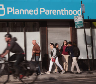 Abortion rights activists criticize Trump ruling against Title X