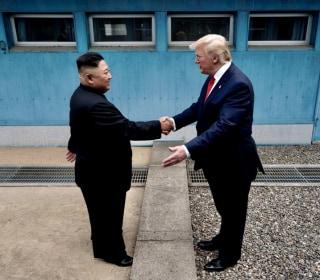 Trump meets Kim Jong Un, becomes first sitting U.S. president to step into North Korea