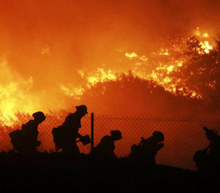 Photos: California fights to contain wind-fueled wildfires