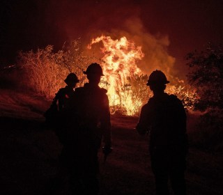 Photos: California battles wind-fueled wildfires