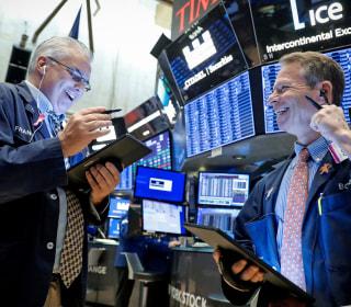 Dow hits record high amid U.S.-China trade optimism