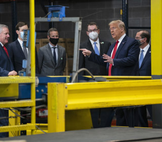 As the coronavirus crisis hits home, Trump hits the trail