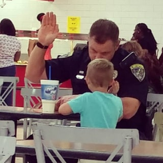 Kindergartner Thanks Police Officer, Is 'Sworn-in' in Adorable Photo