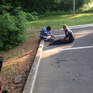 Police Officer Helping Teen With Autism Becomes Viral Photo