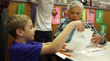 Kids learn cursive and connect with seniors through pen pal
