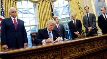 Trump Issues Executive Orders Freezing Federal Hiring, Targeting Trade