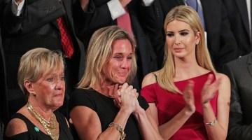 Trump Honors Tearful Wife of Slain Navy SEAL