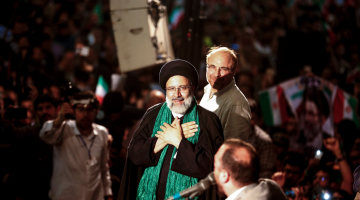 Hardliners Hope To Topple Rouhani in Tight Iran Election