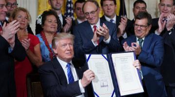 Trump Signs 'Historic' Bill to Transform Veterans Affairs