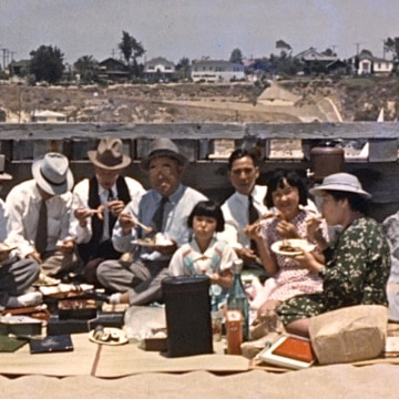A still frame from a home movie, part of a collection of Asian American home movies collected by the Center for Asian American Media (CAAM).