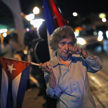 Image: A anti-Castro Cuban exile reacts after the announcement of restoring diplomatic ties between Cuba and U.S., at 'Little Havana' in downtown Miami
