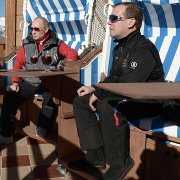 """Image: Russian President Putin and PM Medvedev chat during their visit to the """"Laura"""" cross country ski and biathlon centre in the resort of Krasnaya Polyana near Sochi"""