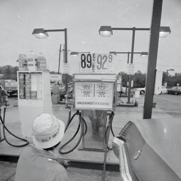 Image: A man pumps unleaded gas