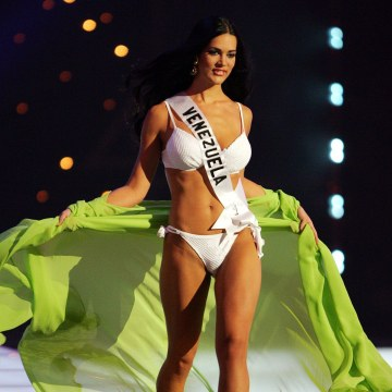 Image: File photo of Miss Universe 2005 contestant Monica Spear of Venezuela, modelling during a swimwear competition in Bangkok