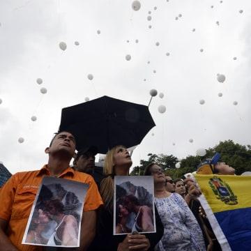 Image: TOPSHOTS-VENEZUELA-CRIME-MISS-SPEAR