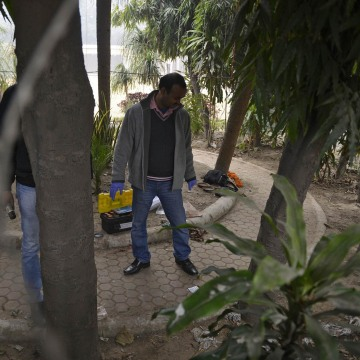 Image: A forensic official examines a spot where a Danish woman alleged she was robbed and gang-raped in New Delhi
