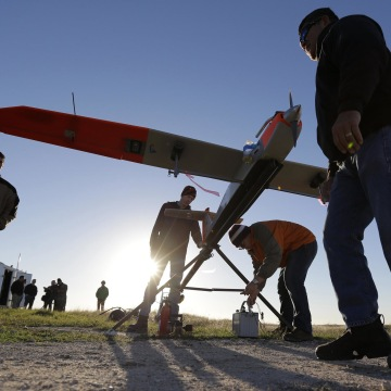 Image: Texas A&M Corpus Christi researchers prepare a unmanned aircraft system for testing